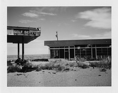 self serve (Eric Baggett) Tags: analog film newmexico polaroid selfserve ghosttowns westtexas texas decay decaying disappearingsmalltowns fujifp100c gasstation abandoned bnwfilm blackandwhitephotography blackandwhite ericbaggett ilovefilm lonely desolate
