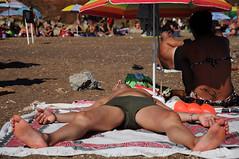 spiaggiato. (LucaBertolotti) Tags: elba isola isoladelba calaseregola tourists turisti toscana italia italy riomarina people umbrellas ombrelloni feet piedi summer