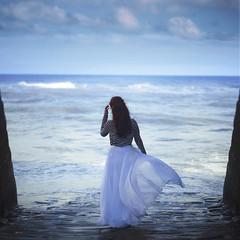 Broken Waves (Diogo Costta) Tags: waves sea dress wind red hair redhair blue sky wall stonewalls breakingwaves broken wave horizon gate portal deep calm ocean cloud sunny dof depth