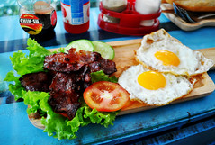 Breakfast on board (Roving I) Tags: baconandeggs breakfast danang dining cafes cyclo friedeggs lettuce tomatoes cucumbers sauces vietnam