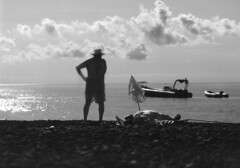 Stromboli, Sicily (fotobloki) Tags: longexposure blackandwhite island volcano grain earlymorning sunbath filter infrared sicily tanning oldercouple stromboli beaching ilfordsfx200
