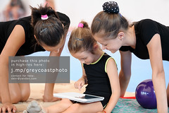 Three gymnast girls with tablet computer (creativemarket.photo) Tags: people girl look sport horizontal modern female computer person three pc kid student portable child watch young pad teen gymnast gymnastics teenager wireless leisure gadget gym tablet sportsman tab touchpad   sportswoman