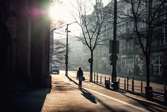 white star (ewitsoe) Tags: street city morning winter light urban sun cold church 35mm cityscape shadows cathedral walk saturday tram poland polska brightlight february citycenter poznan wintery longshadows womanwalking urbanarea nikond80 ewitsoe erikwitsoe