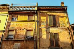 Intonaco (damar47) Tags: street city windows orange sun building sunshine yellow architecture buildings shadows pentax ombre oldhouse bologna historical citycentre finestre intonaco viazamboni pentaxk30
