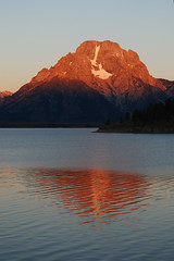 Mt. Moran Sunrise (mike_jacobson1616) Tags: sky lake mountains fog sailboat marina sunrise dawn nationalpark peaks tetons grandteton tetonrange grandtetonnationalpark jacksonlake mtmoran orangesunrise signalmountaincampground