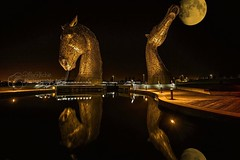 Reflection .... Golden Hour (PMacR) Tags: park sculpture moon reflection art andy water statue metal night river golf gold lights golden scotland clyde boat canal highlands iron central scottish visit tourist forth scot fantasy helix barge attraction tartan grangemouth falkirk kelpies