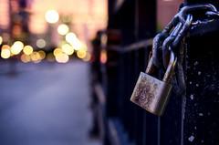 Locked In (flashfix) Tags: august162016 2016 2016inphotos nikond7000 nikon ottawa ontario canada 40mm lock rust bokeh morning fence lines dawn sunrise citylights downtown chain street flashfix flashfixphotography