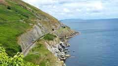 Bray Ireland (sakarip) Tags: railroad ireland sea summer green rock train landscape seaside rocks hiking hill railway eire dart phonephoto cliffwalk hillwalk samsungphone sakarip