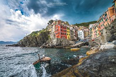 Riomaggiore during a storm (Chiara Salvadori) Tags: bellaitalia cinqueterre fivelands italianriviera laspezia mediterraneansea travelphotography bay beautiful boat cliff clouds coast colors italy landscape lifestyle liguria outdoors places port premiun riomaggiore scenery sea spring sun terraces thunderstorm tourisme travel traveling trip unesco village