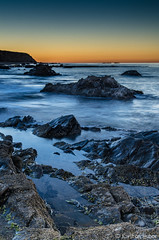 Crystal Cove - Morning - 29 (Karlton Huber) Tags: ocean california morning sky orange seascape motion color beach nature wet yellow sunrise reflections landscape sand rocks colorful waves pacific horizon shoreline peaceful pebbles crystalcove pacificocean lowtide cloudless southerncalifornia inspirational tidepool invigorating theoc shimmer naturephotography 2014 landscapephotography silkywater revitalizing nikond7000 karltonhuber