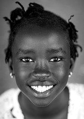 Miss Omega, Anuak Tribe, Gambela, Ethiopia (Eric Lafforgue) Tags: africa girls portrait people blackandwhite black eye girl smile childhood smiling vertical horizontal closeup female youth hair outdoors person women day child african sudan border young tribal christian braids ethiopia tribe hairstyle humanbeing oneperson braided hornofafrica ethiopian eastafrica toothysmile lookingatcamera squarepicture childrenonly africanethnicity 1people gambela itang anuak africanculture onegirlonly gambella onechildonly anyuak agnwak anywaa ethiopianethnicity gambelagambella ethio1404970