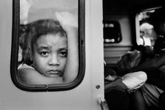 A boy in the Jeepney (SungsooLee.com) Tags: street leica trip travel boy people blackandwhite bw film face blackwhite child kodak iso400 28mm trix philippines summicron journey mp f2 asph typhoon jeepney haiyan tacloban tx400 sungsoolee