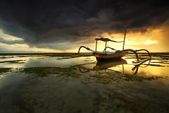 Pantai Karang Sanur Bali (KembaraAlam) Tags: travel bali seascape seaweed sunrise landscape boat scenery cloudy adventure goldenhour sanur pantaikarang kembaraalam