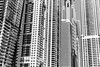 (Rory Holmes) Tags: blackandwhite white black tower geometric monochrome lines architecture contrast marina marriott 35mm buildings grey hotel nikon dubai skyscrapers uae gray torch highrise tall simple unitedarabemirates damac thetorch d5200