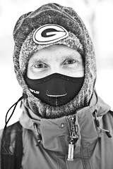 Spencer9 (local paparazzi (isthmusportrait.com)) Tags: portrait blackandwhite bw white black cold detail blancoynegro blanco hat contrast logo person eos 50mm prime iso800 frozen interesting pod eyes flickr raw photographer mask unique f14 g negro grain snowstorm freezing clarity stranger teacher hidden odd human jacket freeze layer zipper layers chilly usm madisonwi masked february noise snowfall oddity ef pupils greenbaypackers snowcovered brr subzero sharpness 2015 froze f20 canonraw cr2 50mmf14usm 100strangers danecountywisconsin photoshopelements7 canon5dmarkii nifty50mm localpaparazzi redskyrocketman lopaps isthmusportrait 608strangers spencer9