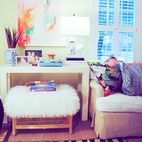 Decorate in layers-- note rugs, accessories, and furniture. Your home will instantly look more intentional, collected, and in @enewmanid's case, chic!!! Thanks for sharing your #SocietySocial rattan and faux Mongolian fur ottoman, Elizabeth! We miss you a