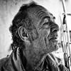 smile#2- (big andrei) Tags: leica portrait bw man smile village grain cyprus compact dlux nicosia ayiamarina