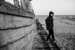 On the Tracks (marc_morris1982) Tags: uk blackandwhite abandoned beach canon mono boat wooden kent fishing tracks rail railway pebbles pebble dungeness rotten derelict bnw derilict 600d
