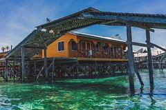 Wooden bridge at Mabul Island (Syahrel Azha Hashim) Tags: ocean travel bridge light vacation holiday detail water colors beautiful architecture clouds 35mm island prime colorful dof getaway sony details naturallight nopeople structure malaysia tropical tropicalisland handheld shallow woodenhouse simple dramaticsky woodenbridge sabah clearsky clearwater a7ii colorimage semporna housesonstilts mabulisland sonya7 syahrel ilce7m2