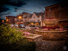 Night falls on the Green (brianloganphoto) Tags: street railroad flowers ny newyork brick clouds buildings garden evening us mainstreet village unitedstates cloudy bricks rail transportation shops bluehour orangecounty stores warwick commerical