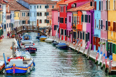 Burano Glory (stephencurtin) Tags: people italy buildings boats canal colorful vibrant burano