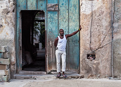 Standing at the Door (Mitch Ridder Photography) Tags: cuba cuban cubanlife cubanstreets cubanstreetlife havana havanacuba havanastreets cubancapitol cubanisland island islandofcuba caribbean caribbeanisland largestcaribbeanisland communist communistcountry travel travelphotography cameravoyages workshop photoworkshop photoworkshopincuba photojournalism mitchridder mitchridderphotography mitchridderphotographyallrightsreserved2016 streetphotography cubanman doorway