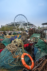 Life bouy and fishing nets (Shahid A Khan) Tags: architecture colours descriptivewords england english nature places religions seasons travel uk abstract background blue buoy circle coast cord devon equipment ferriswheel fish fishing fishnet foreground green harbor harbour hill industry knot life lifebuoy lifesaver line marina marine mesh net nets netting old orange port red ring rope sea seaside south texture torquay town white sakhanphotography shahidakhan photography picture photograph images