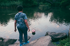 Football in the pond (L. A. Nolan) Tags: 185mmf28 28mm boy centralpark day fujifilmx70 manhattan newyork newyorkcity newyorknewyork ny nyc outdoors outside people pond soccerball streetphotography theempirestate trees water