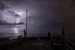 Danger on the Rocks (Bobby Wummer) Tags: red lightning thunderclouds thunderstorms thunderstorm weather storms stormchaser stormchasing oceanstorm ocean oceanscape outdoors nightphotography longexposure nightscape night