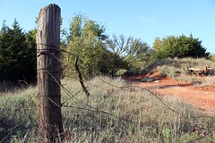 keep me posted. (caralampton) Tags: country barbed wire fense post old forgotten farm red dirt oklahoma