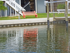 Red (soniaadammurray - OFF) Tags: digitalphotography bench stairs dock water house sea reflections windows grass happybenchmonday red