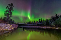 Dancing Sky (Nelepl) Tags: auroraborealis northernlights manitoba canada pinawa channel river water suspension bridge night nightcap landscape autumn fall october canadian shield rocks forest whiteshell provincial park sky dancing reflection