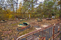 Pripyat Amusement Park (Chernobyl Exclusion Zone)_7 (Landie_Man) Tags: none pripyat chernobyl ionising radiation radioactive fair fairground amuse amusements amusement park may day parade soviet union ussr cccp disused abandoned forgotten left sad never opened ran communism communist fun ferris wheel bumper cars dodgems swing ride swings nature reclaim redstar red star cliche clche