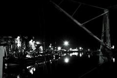Harbour by Night Mono (jon.warr) Tags: harbour sea city travel seaside water longexposure night low light boat boats architecture fresh