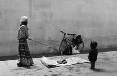 Im waiting (its Jason B) Tags: street blackandwhite woman london bike night photo child small bubbles 2014