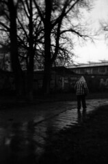 Holga 120FN - Man Walking in the Rain (Kojotisko) Tags: street city people bw streets person holga czech streetphotography brno cc creativecommons czechrepublic streetphoto persons fomapan holga120fn