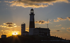 Dawn Breaks and a New Year Begins (gimmeocean) Tags: lighthouse ny newyork sunrise longisland flare montauk newyearsday easthampton montaukpointlighthouse montaukpointstatepark montaukpointlight