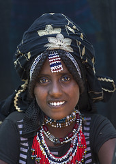 Afar Tribe Woman, Assaita, Afar Regional State, Ethiopia (Eric Lafforgue) Tags: africa portrait people haircut beauty smile face smiling vertical female scarf hair outdoors women day african headscarf culture lifestyle tribal bead braids females shawl tradition ethiopia tribe ethnic hairstyle beautifulpeople anthropology oneperson frontview traditionalculture adornment hornofafrica individuality ethnology ethiopian afar eastafrica braidedhair traditionalclothing humanface darkbackground beadednecklace onewomanonly lookingatcamera colorpicture oneyoungwomanonly danakil africanethnicity pastoralists 1people indigenousculture africanculture onlywomen nomadicpeople traditionallifestyle colourpicture assaita asaita assayta oneteenageronly oneyoungadultonly africantribalculture ethio1406982