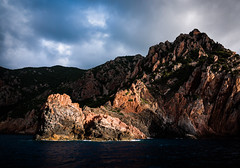Corse 041 (arsamie) Tags: cruise light red sea orange mountain storm water rock dark boat mediterranean waves corse corsica reserve clair calanques obscur piana scandola calanches