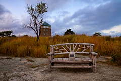 Windswept (SunnyDazzled) Tags: statepark autumn sunset newyork tower history tourism clouds bench evening wooden carved memorial scenery hand handmade landmark bearmountain perkins grasses tall