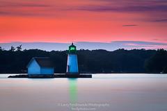 Sunken Rock Lighthouse (Larry Ferdinande) Tags: alexandriabay motorcycletrip newyork stlawrenceriver sunkenrocklighthouse atrc green harley motorcycle sunset bonniecastleresort river