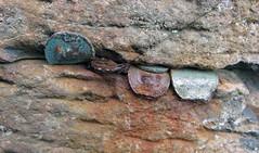 Coins jammed into he striking hexagonal basalt rock formations of Giant's Causeway in Northern Ireland, UK (albatz) Tags: giantscauseway ireland uk rockformations basalt coins