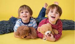 x-default (nohoritachildrensclothing1) Tags: happy kids brothers siblings hugging toys stuffed animals preschoolers toddlers little young children boys playing games fun playtime eskimokiss affectionate loving friends social laughing yellow copyspace indoors studio childhood education together