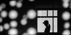 F_DSC6500-BW-Nikon D800E-Nikkor 28-300mm-May Lee  (May-margy) Tags: maymargy  expecting bw                taiwan repofchina fdsc6500bw portrait silhouette window  cross linesformandlightandshadows streetviewphotographytaiwan mylensandmyimagination naturalcoincidencethrumylens blur bokeh keelungcity nikond800e nikkor28300mm maylee