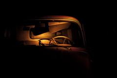 outside of time (Maureen Bond) Tags: truck light night dark steeringwheels rope shadow visor idaho maureenbond glass moment frozen time