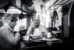 New article on my Blog (marcin baran) Tags: street streetphotography streetphoto stranger streets candid candidphotography candidshot people eating restaurant eye eyecontact black blackwhite blackandwhite bw mono monochrome strangers human element factor city urban gliwice poland polska marcinbaran fuji fujifilm fujix100 x100 x100t