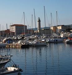 Trieste - Reflecting on a Captivating Coastal City! (antonychammond) Tags: trieste adriatic gulfoftrieste friuliveneziagiuliaandtriesteprovince italy austrohungarianempire portoftrieste harbour boats lighthouse reflections worldwidepanorama