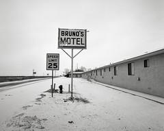 Bruno's Motel, Gerlach, Nevada (austin granger) Tags: winter snow film sign hole nevada motel burningman roadside brunos gerlach blackrockdesert pentax67 austingranger