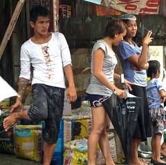 Rainy Day at Murphy Market (mikeeliza) Tags: city man feet rain women san eyecontact pretty rainyday juan legs market philippines young handsome manila denim filipino marketplace pinay filipina pinoy mikeeliza murphymarket
