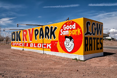 good sam park #2. holbrook, az. 2007. (eyetwist) Tags: red camp arizona usa postprocessed west sign yellow clouds america photoshop typography office route66 nikon exposure desert parking roadtrip 66 billboard container route filter american highdesert handpainted type interstate arrow 40 lettering roadside rv nikkor campground oblique motorhome processed cloudporn holbrook i40 2007 overnight lightroom typographic rt66 postprocessing motherroad us66 alienskin goodsam conex lowrates 18200mmf3556gvr d80 eyetwist bypassed fadingamerica nikcolorefex nikond80 goodsampark eyetwistkevinballuff americantypology signgeeks